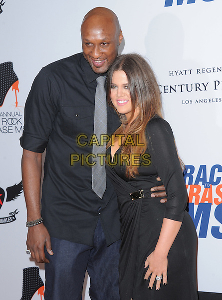Lamar Odom & Khloe Kardashian Odom.at The 19th Annual Race to Erase MS Gala held at The Hyatt Regency Century Plaza Hotel in Century City, California, USA, May 18th 2012..half length shirt grey gray tie husband wife couple black wrap dress .CAP/RKE/DVS.©DVS/RockinExposures/Capital Pictures.