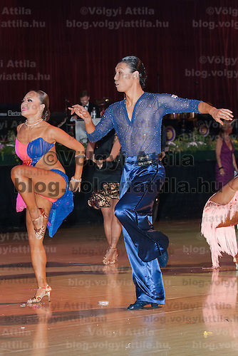 Motomitsu Shimizu and Miyuki Maruichi of Japan perform their dance during the Professional Latin-american competition of the Blackpool Dance Festival is the most famous event among dance competitions held in Blackpool, United Kingdom on June 01, 2011. ATTILA VOLGYI