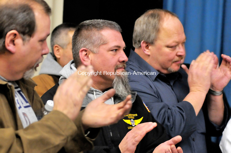 CHESHIRE, CT-06 FEBRUARY 2009-020610JS11- Mark Nati of Wallingford, left, Mike Frei of Old Saybrook, center and Randy Colter of Southington, all worker at Pratt &amp; Whitney Cheshire Enjine Center. applaud during a press conference Saturday at the IAM Local 1746 Hall in East Hartford. On Friday, Connecticut U.S. District Judge Janet Hall issued an injunction against Pratt &amp; Whitney, prohibiting them from moving work and equipment out of their Cheshire and East Hartford CARO operations. <br /> Jim Shannon Republican-American