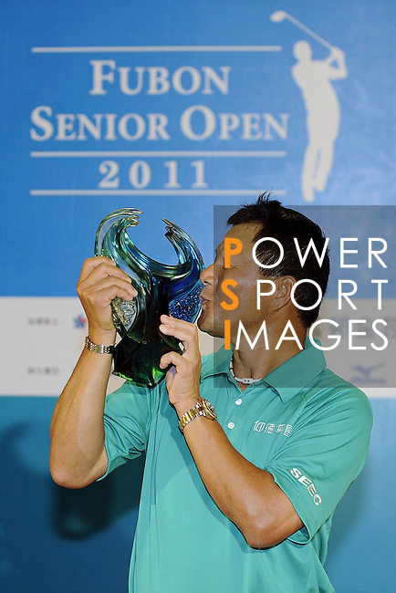 TAIPEI, TAIWAN - NOVEMBER 20:  Lu Chien Soon of Taiwan poses with the trophy after winning the Fubon Senior Open at Miramar Golf & Country Club on November 20, 2011 in Taipei, Taiwan.  Photo by Victor Fraile / The Power of Sport Images