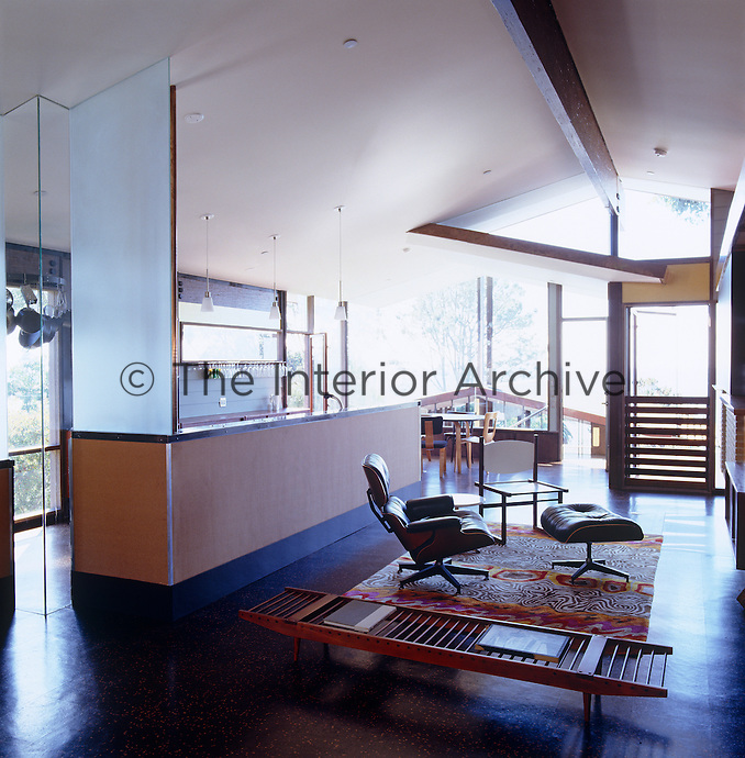 The living area is a large open-plan space incorporating a kitchen, a dining area and a sitting room