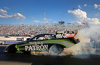 Sep 13, 2013; Charlotte, NC, USA; NHRA funny car driver Alexis DeJoria during qualifying for the Carolina Nationals at zMax Dragway. Mandatory Credit: Mark J. Rebilas-