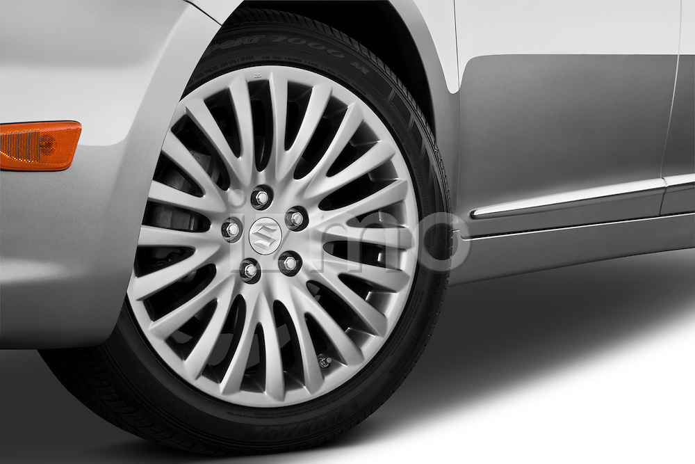 Tire and wheel close up detail view of a 2010 Suzuki Kizashi SLS