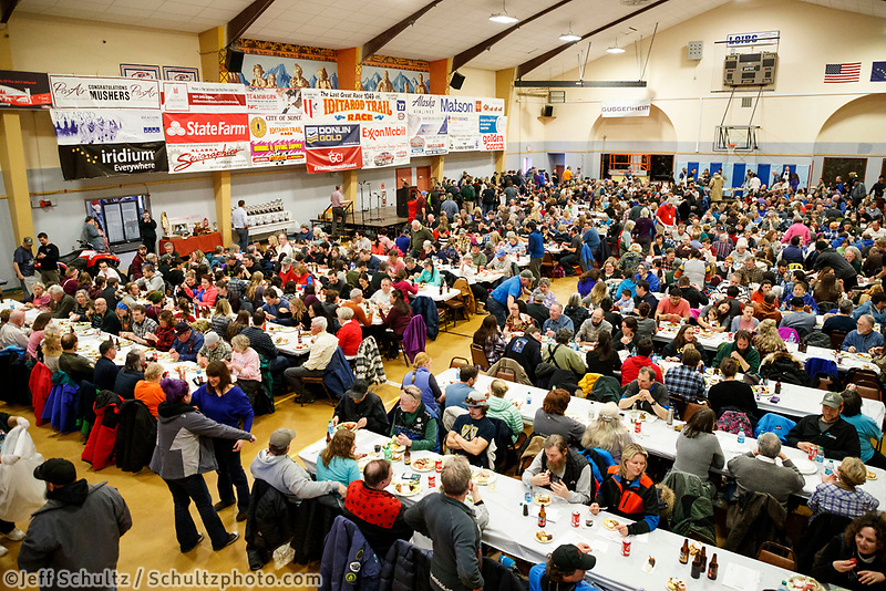 A packed house enjoys the Nome Musher's Award Banquet at the city recreation center during the 2017 Iditarod on Sunday March 19, 2017.<br /> <br /> Photo by Jeff Schultz/SchultzPhoto.com  (C) 2017  ALL RIGHTS RESERVED