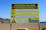 Beach danger sign Los Escullos, Cabo de Gata national park, Almeria, Spain