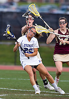 Virginia Crotty (22) of Duke takes a shot as she is fouled by Jill Rekart (2) of Boston College during the first round of the ACC Women's Lacrosse Championship in College Park, MD.  Duke defeated Boston College, 17-6.
