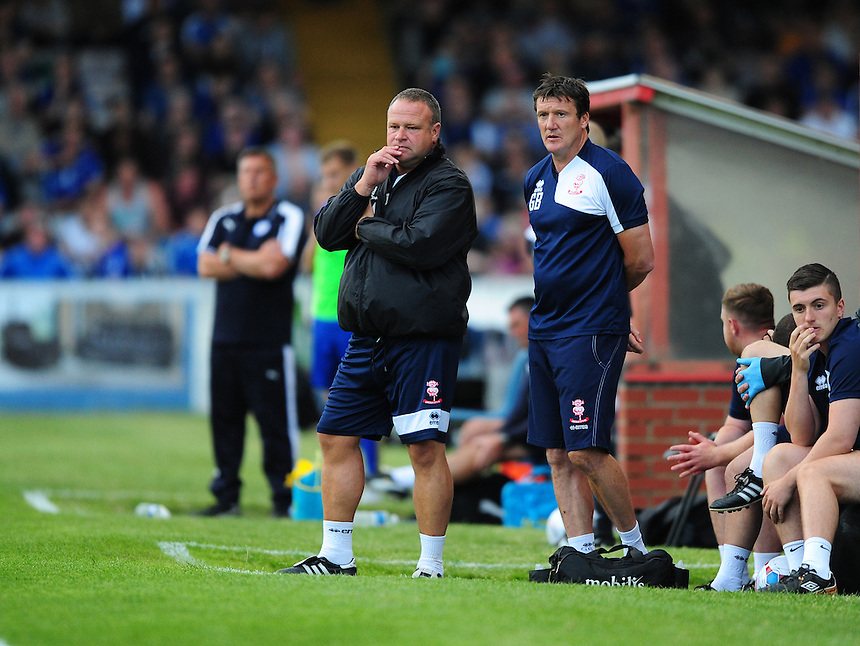 Lincoln City manager Chris Moyses, left, and Lincoln City's assistant manager Grant Brown<br /> <br /> Photographer Chris Vaughan/CameraSport<br /> <br /> Football - Football Friendly - Lincoln City v Leicester City - Tuesday 21st July 2015 - Sincil Bank - Lincoln<br /> <br /> &copy; CameraSport - 43 Linden Ave. Countesthorpe. Leicester. England. LE8 5PG - Tel: +44 (0) 116 277 4147 - admin@camerasport.com - www.camerasport.com