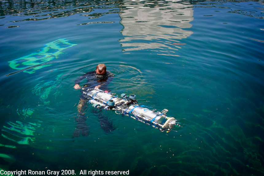 TRANSEC Sonar Test Basin, Point Loma, San Diego, CA, USA.Friday, August 1 2008.  US NAVY Diver Martin Stacy recovers an Autonomous Underwater Vehicle bulit by students at the Kyushu Institute of Tecnolgy Japan.