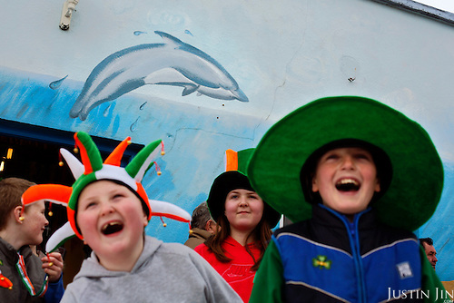 Children enjoy St Patrick's day in Dingle, County Kerry, on the west coast of Ireland, home of the famed dolphin Fungi..In 1984, the lone dolphin was observed escorting the fishing boats. The fishermen named him Fungi. Within months, he had become such a fixture that local officials declared him a permanent resident. .For more than 20 years, Fungi has stayed in the harbour and befriending humans, becoming one of Ireland's top attractions..Every summer, Dingle town?s 3,000 inhabitants are overrun by tourists, who have come to see Fungi on boat trips..Fungi, a male bottlenose, is around 30 years old. He weighs about 250 kilos and is about four metres in length. .