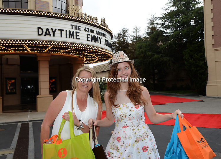 Ashlyn Pearce and mother Lisa Pearce attends the 2015 Daytime Emmy Gifting Suite on April 25, 2015 at Warner Brothers Stuido Lot  in Burbank, California, USA. The gift lounge was presented by OffTheWallIdeas.com.