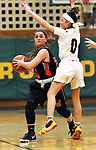 WATERBURY CT. 16 February 2018-021619SV22-#34 Chloe DeFeo of Watertown High looks to pass as #0 Aamya Rivera of Sacred Heart High defends during the NVL girl&rsquo;s basketball tournament in Waterbury Saturday.<br /> Steven Valenti Republican-American