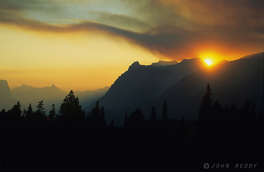 Smoke from forest fire adds drama to sky, Glacier National Park, Montana, USA