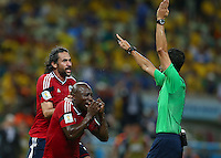 Mario Yepes and Pablo Armero of Colombia reacts as they have a goal disallowed at 1-0
