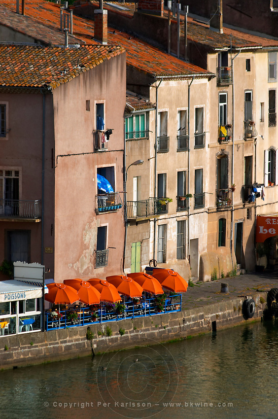 Restaurants along the l'Herault river. L'Herault river. Agde town. Languedoc. France. Europe.