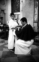 Roma  Luglio 2001.Venerabile Arciconfraternita Di Maria Ss. Del Carmine In Trastevere a Roma fondata nell' anno 1538..Due Confratelli prima della processione.<br /> http://www.arciconfraternitadelcarmine.it/