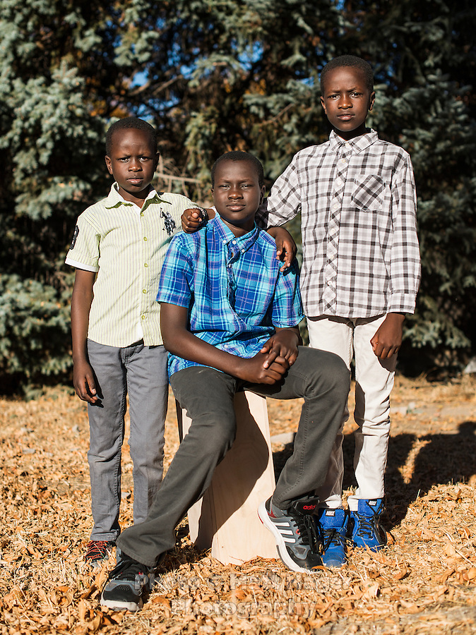 Mary Kuanen's children Bang Malual (age 13 in blue), Emmanuel Malual (age 7 in green), and Malual Malual (age 10 in white) at home in Denver, Colorado, Friday, October 21, 2016. Kuanen has five children including a daughter and her oldest son, who is in college in Denver.<br /> <br /> Photo by Matt Nager