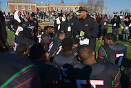 November 28, 2013  (Washington, DC) H.D. Woodson head coach Steven Scott talks to his players after winning the 2013 DCIAA varsity football championship game November 28, 2013. Woodson defeated Wilson 25-13. (Photo by Don Baxter/Media Images International)
