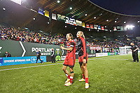Portland, OR - Saturday, May 21, 2016: Portland Thorns FC midfielder Tobin Heath (17) and midfielder Allie Long (10) after the match. The Portland Thorns FC defeated the Washington Spirit 4-1 during a regular season National Women's Soccer League (NWSL) match at Providence Park.