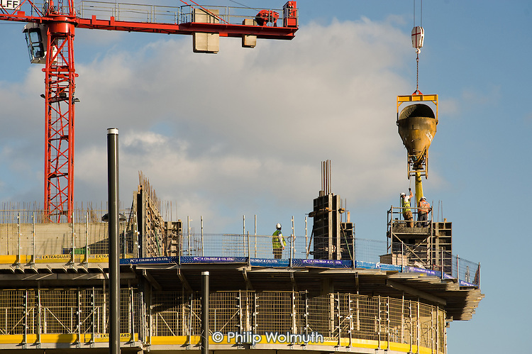 Construction workers on a building next to the site of the London 2012 Olympic Games, Stratford.