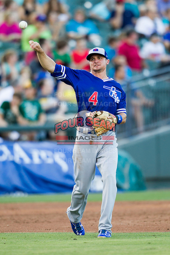 Oklahoma City Dodgers third baseman Buck Britton (4) makes a throw to first base during the Pacific Coast League baseball game against the Round Rock Express on June 9, 2015 at the Dell Diamond in Round Rock, Texas. The Dodgers defeated the Express 6-3. (Andrew Woolley/Four Seam Images)