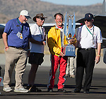 "Robert ""Hoot"" Gibson holds the trophy after winning the Unlimited Championship during the National Championship Air Races at the Reno-Stead Airfield Sunday, Sept. 20, 2015."