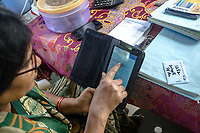 Padmaja, Safe Water Network iJal station operator uses a tablet device at the facility in Rangsaipet, in Waragal, Telangana, Indiia, on Saturday, February 9, 2019. Photographer: Suzanne Lee for Safe Water Network