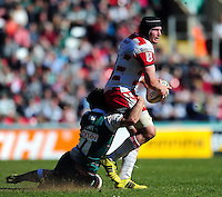 Ben Morgan of Gloucester Rugby is tackled by Will Evans of Leicester Tigers. Aviva Premiership match, between Leicester Tigers and Gloucester Rugby on April 2, 2016 at Welford Road in Leicester, England. Photo by: Patrick Khachfe / JMP
