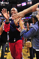 AJ Price of the Wizards gives high five to the fans prior to tip-off against the visiting Boston at the Verizon Center in Washington, D.C. on Saturday, November 3, 2012.  Alan P. Santos/DC Sports Box