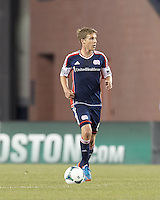 New England Revolution midfielder Scott Caldwell (6) brings the ball forward.  In a Major League Soccer (MLS) match, Montreal Impact (white/blue) defeated the New England Revolution (dark blue), 4-2, at Gillette Stadium on September 8, 2013.