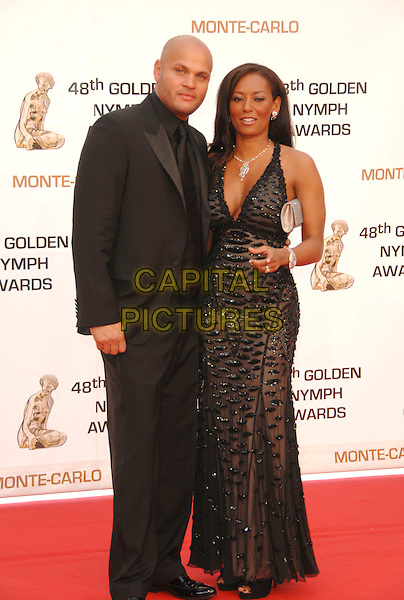 STEPHEN BELAFONTE & MELANIE BROWN.At the Golden Nymph awards ceremony during the 2008 Monte Carlo Television Festival held at Grimaldi Forum, Monte Carlo, Principality of Monaco, .June 12, 2008..full length Mel B scary spice girl black beaded dress maxi long cleavage married husband wife suit.CAP/TTL.©TTL/Capital Pictures