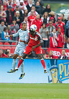 Sporting KC forward Teal Bunbury #9 and Toronto FC defender Nana Attakora #3 in action during an MLS game between Sporting Kansas City and the Toronto FC at BMO Field in Toronto on June 4, 2011...