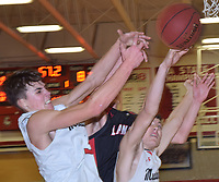 RICK PECK/SPECIAL TO MCDONALD COUNTY PRESS<br /> McDonald County's Cale Adamson (left) and Cade Smith (right) battle for a rebound during the Mustangs' 65-61 loss to the Lamar Tigers on Jan. 18 at MCHS.