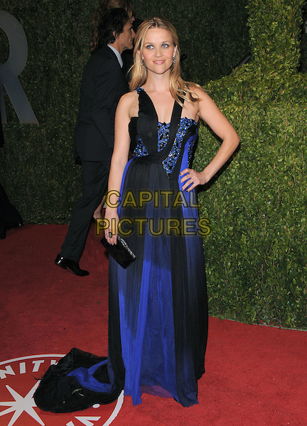REESE WITHERSPOON.The 2009 Vanity Fair Oscar Party held at The Sunset Tower Hotel in West Hollywood, California, USA..February 22nd, 2009.oscars full length black blue silver sheer dress clutch bag long maxi hand on hip.CAP/DVS.©Debbie VanStory/Capital Pictures.