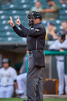 Umpire Lee Meyers handles the calls behind the plate during the game between the Salt Lake Bees and the Tacoma Rainiers at Smith's Ballpark on May 27, 2019 in Salt Lake City, Utah. The Bees defeated the Rainiers 5-0. (Stephen Smith/Four Seam Images)