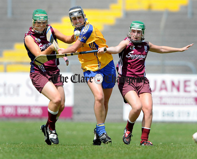 Galwy's Colette Gill and Heather Cooney move in on Clare's Siobhan Keniry during their Intermediate championship game at Athentry. Photograph by John Kelly.