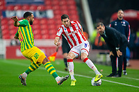 4th November 2019; Bet365 Stadium, Stoke, Staffordshire, England; English Championship Football, Stoke City versus West Bromwich Albion; Stephen Ward of Stoke City under pressure from Matt Phillips of West Bromwich Albion - Strictly Editorial Use Only. No use with unauthorized audio, video, data, fixture lists, club/league logos or 'live' services. Online in-match use limited to 120 images, no video emulation. No use in betting, games or single club/league/player publications