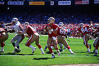 SAN FRANCISCO, CA - Quarterback Steve Young of the San Francisco 49ers in action during a game against the New England Patriots at Candlestick Park in San Francisco, California in 1995. Photo by Brad Mangin