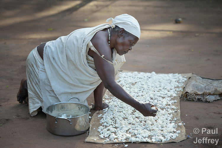 Perna Jacob dries cassava in a camp for more than 5,000 displaced people in Riimenze, in South Sudan's Gbudwe State, what was formerly Western Equatoria. Families here were displaced at the beginning of 2017, as fighting between government soldiers and rebels escalated.<br /> <br /> Two Catholic groups, Caritas Austria and Solidarity with South Sudan, have played key roles in assuring that the displaced families here have food, shelter and water.<br /> The camp formed around the Catholic Church in Riimenze as people fled violence in nearby villages for what they perceived as the safety offered by the church.