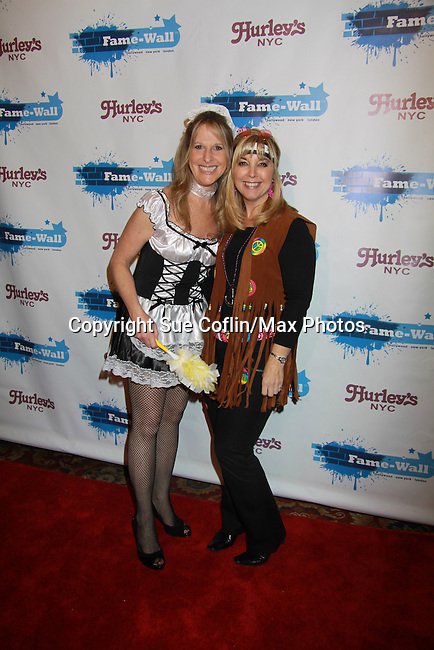 Marcia Tovsky and friend dress up at Fame-Wall New York with the unveiling of her portrait by famed painter Jim Warren and a celebration of Broadway's The Addams Family at a Halloween Party on October 28, 2011 at Hurley's NY, New York City, New York.  (Photo by Sue Coflin/Max Photos)