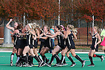 09 November 2014: Wake Forest players celebrate after the game. The Wake Forest University Demon Deacons played the Syracuse University Orange at Jack Katz Stadium in Durham, North Carolina in the 2014 Atlantic Coast Conference NCAA Division I Field Hockey Championship Game. Wake Forest won the ACC Championship game 2-0.