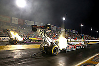 Sep 27, 2013; Madison, IL, USA; NHRA top fuel dragster driver Steve Torrence (near lane) races alongside Pat Dakin during qualifying for the Midwest Nationals at Gateway Motorsports Park. Mandatory Credit: Mark J. Rebilas-