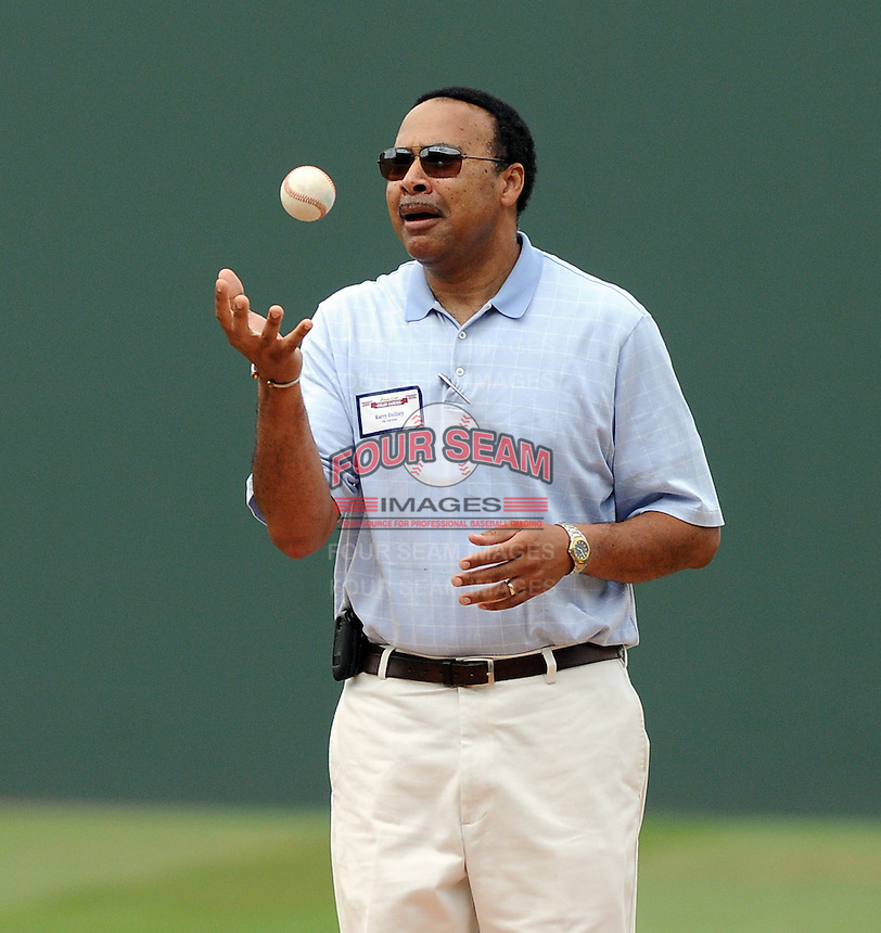 """Spartanburg magistrate court judge Karry Guillory, a colon cancer survivor, throws out the first pitch for colon cancer awareness Sunday at Fluor Field at the West End. It was """"Drive Out Colon Cancer"""" day at the Greenville Drive game sponsored by BlueCross BlueShield of South Carolina. The Drive lost to intrastate rival Charleston RiverDogs, 7-5. (Tom Priddy/Four Seam Images)"""