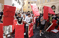 """Dimostranti sorreggono cartelli rossi di fronte a Montecitorio durante la protesta """"No rigore"""" contro il ddl sul lavoro, Roma, 14 giugno 2012..Demonstrators hold signs representing red cards in front of the Lower Chamber building during the """"No Penalty"""" (meant as """"No uprightness"""") protest against the law by decree on labour, in Rome, 14 june 2012. The sign at left reads """"Monti, you are espelled"""", aimed to the Italian Premier Mario Monti..UPDATE IMAGES PRESS/Riccardo De Luca"""