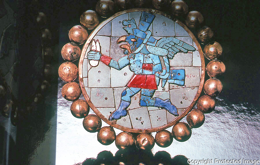 World Civilization:  Moche Culture--one of a pair of gold ear ornaments, running figure in gold, semiprecious stone and shell.