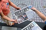 September 8th, 2013 : Tokyo, Japan - A vender gave out special editions of Mainichi Newspaper as Tokyo was selected to host the 2020 Olympics and Paralympics at Shinjuku Station, Shinjuku, Tokyo, Japan on September 8, 2013. (Photo by Koichiro Suzuki/AFLO)