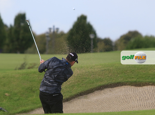 Simon Thornton (IRL) plays out of a bunker on the 18th during the final round of the 106th Irish PGA Championship at Moyvalley Hotel &amp; Golf Resort, Moyvalley, Co. Kildare.  25/09/2016.<br /> Picture: Golffile | Thos Caffrey<br /> <br /> <br /> All photo usage must carry mandatory copyright credit     (&copy; Golffile | Thos Caffrey)