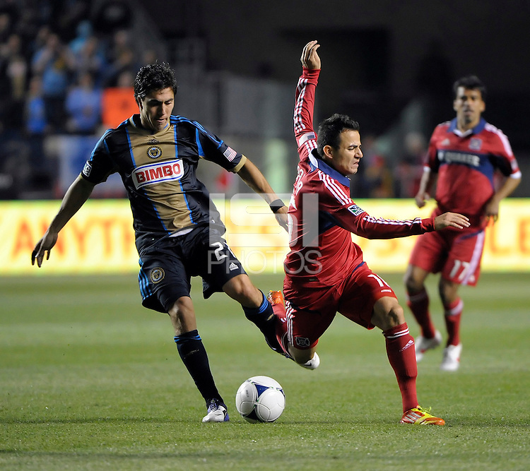Philadelphia Union defender Michael Farfan (21) trips up Chicago Fire midfielder Marco Pappa (16).  The Chicago Fire defeated the Philadelphia Union 1-0 at Toyota Park in Bridgeview, IL on March 24, 2012.