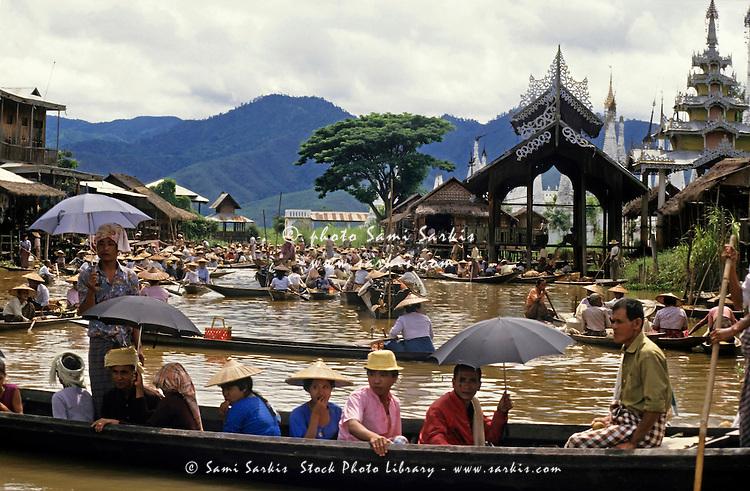 People on rowboats at the Yumana Floating Market on Inle Lake, Burma.