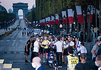 yellow jersey / GC leader Tadej Pogačar (SVN/UAE-Emirates) taking a quick reminder photo with his team(mates) in front of an empty Champs-Élysées with the Arc de Triomphe as a backdrop<br /> <br /> Stage 21 from Mantes-la-Jolie to Paris (122km)<br /> <br /> 107th Tour de France 2020 (2.UWT)<br /> (the 'postponed edition' held in september)<br /> <br /> ©kramon