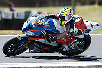 Ivan Clementi (ITA) riding the BMW S1000 RR (18) of the HTM Racing team rounds turn 11 during a practise session on day two of round one of the 2013 FIM World Superbike Championship at Phillip Island, Australia.